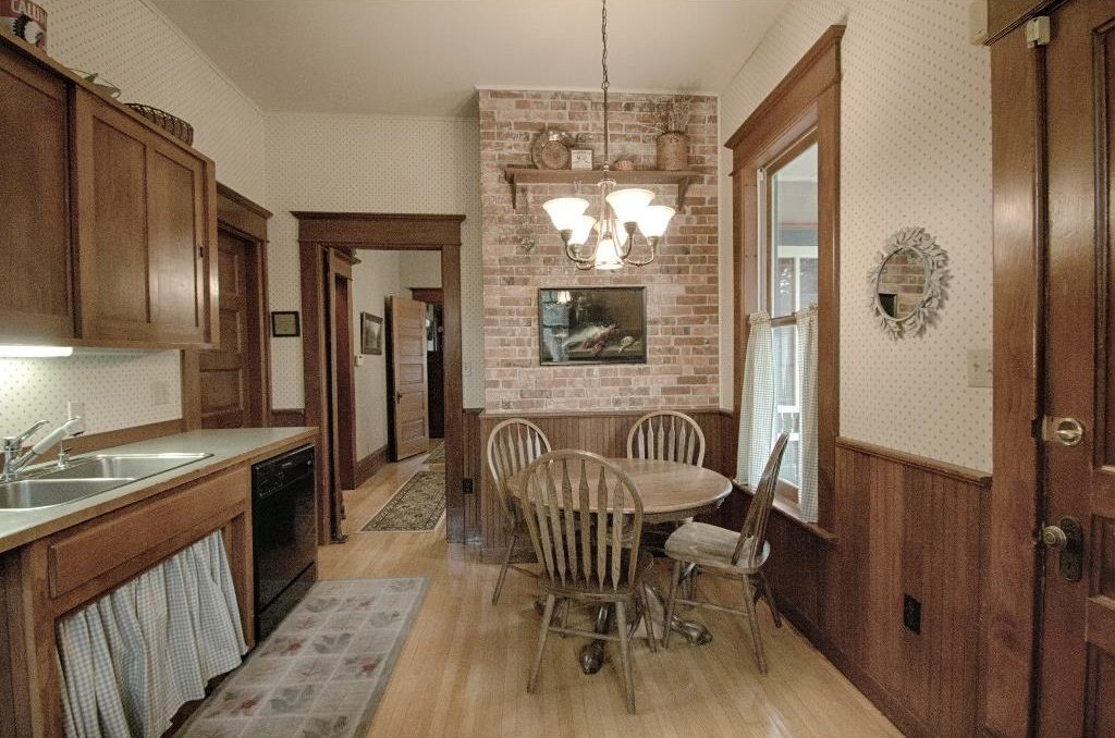 1897 Queen Anne in Iowa on the market - Kitchen has exposed brick and original kitchen