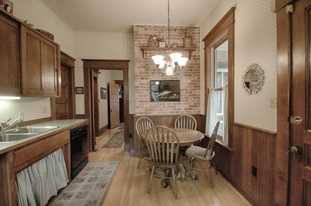 1897 Queen Anne in Iowa on the market - Kitchen has exposed brick and original kitchen