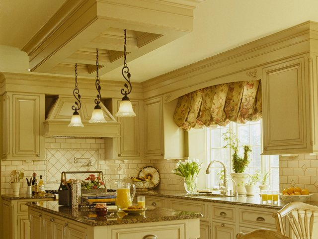 creamy yellow kitchen cabinets