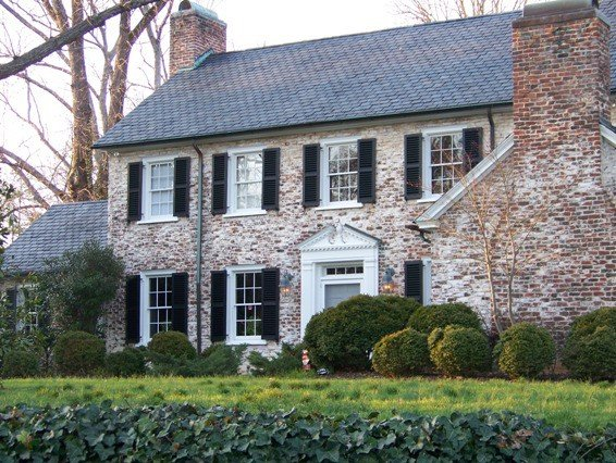 a white washed brick exterior on a traditional style house that gives it that old world feeling