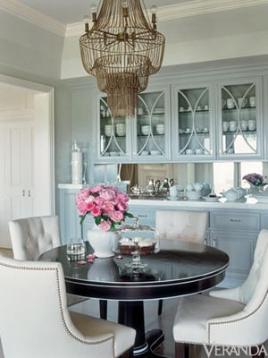 Dramatic Black Table Surrounded By The White Chairs Mirrors Oven And Kitchen Counter Tops In Photo Above
