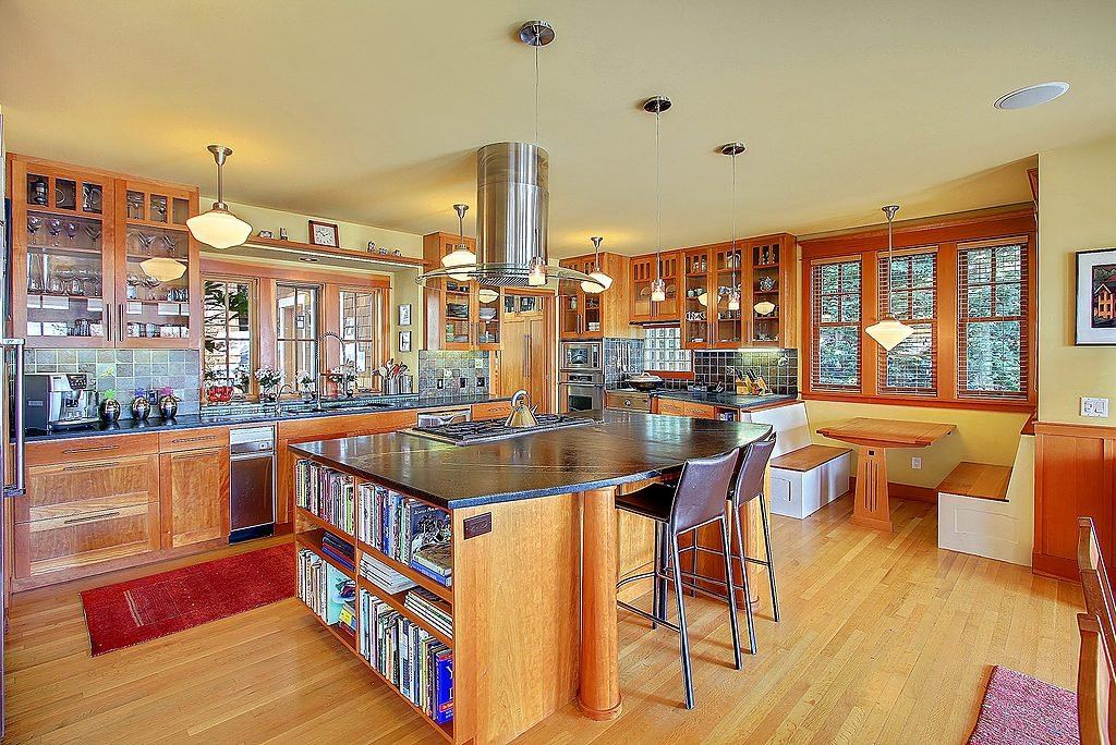 Housekaboodle -Craftsman kitchen  in a waterfront Craftsman Home is the Architects own design. Adore all the storage in the island. Check out the restaurant style seating