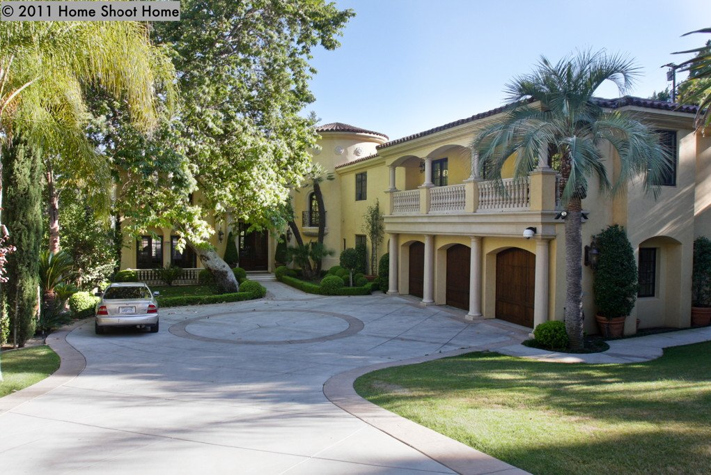 Circular driveway and great balcony above the three car garage. That ...