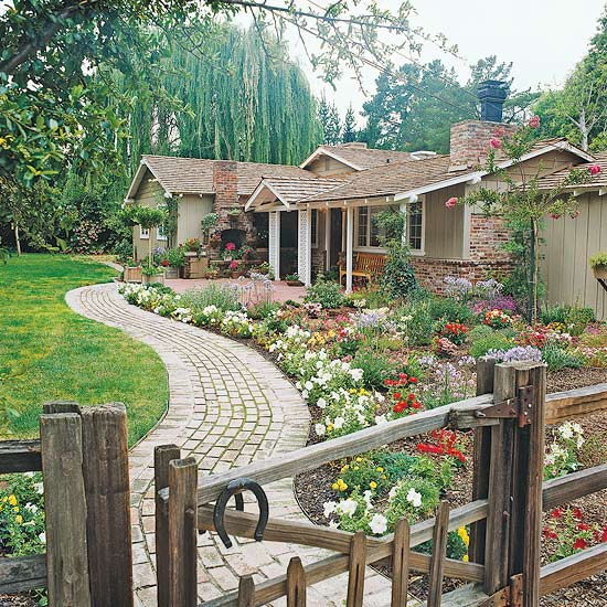 Homes in Lovely settings: A curvy path bordered by a lush flower garden