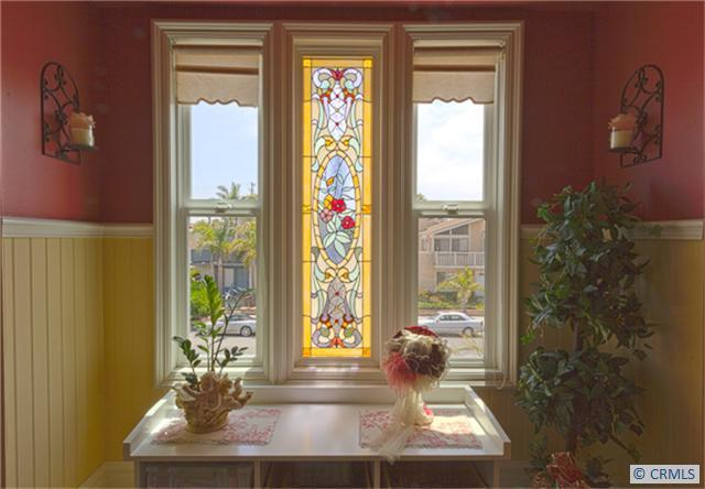 Victorian house with stained glass window