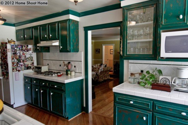 Green colored kitchen cabinets