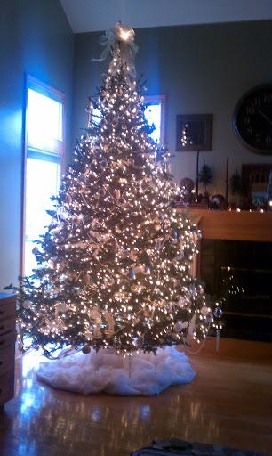 adding ornaments to Christmas tree