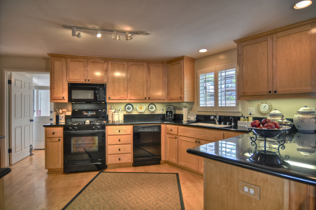 Black countertops and black appliances make a dramatic effect