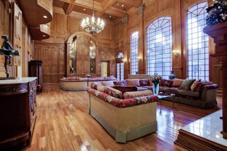 Great room with walls of wood moulding