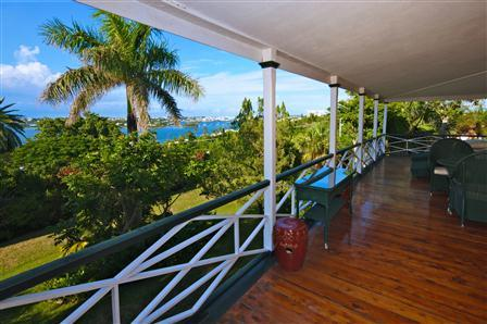 Covered porch with harbor views in Bermuda