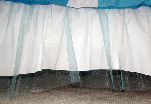 Turquoise tulle bedskirt side view