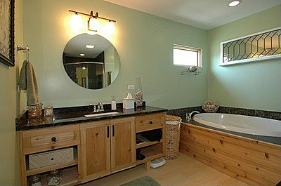 Bathroom has pine or hickory wood