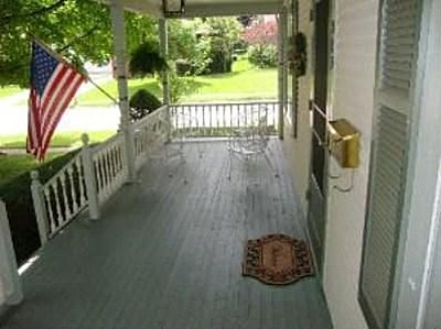 charming yelllow house big porch