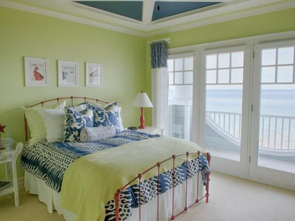 Bedroom with view of lake - Lime green and blue cottage bedroom