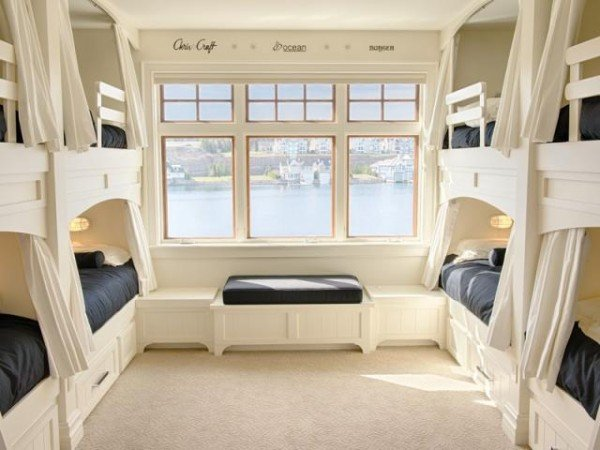 Four bunkbeds in a bedroom