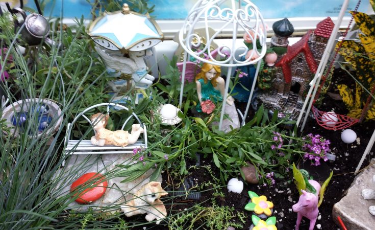 fairy garden made out of toys