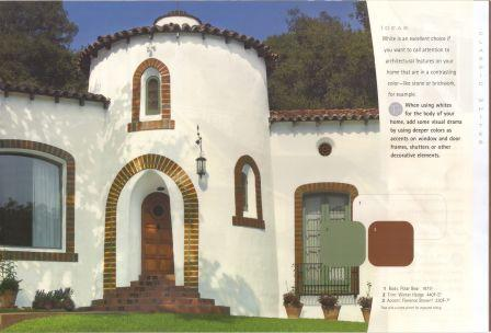white stucco house with dark trim