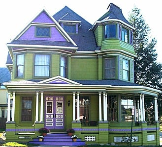 Classic Victorian home in purple and green