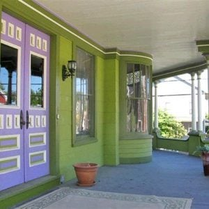 Victorian home front door painted purple and white