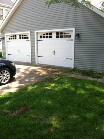 Carriage style garage doors.