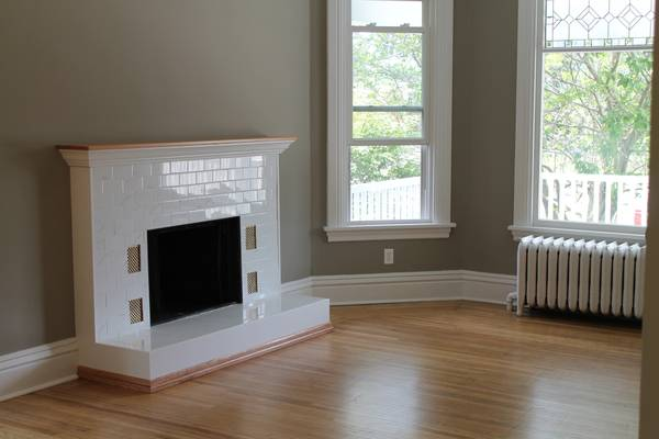 Renovated Victorian subway tiled fireplace.