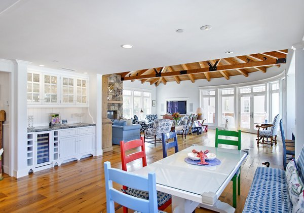 Beach House - This is so much fun to see the brightly colored whimsical chairs paired with the bench seating.