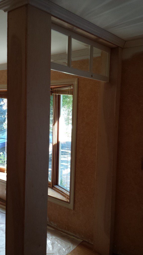 Column for half wall entry and added top trim