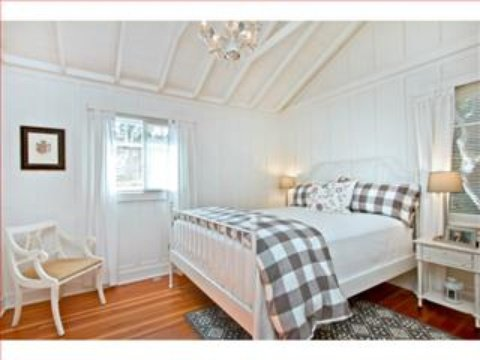 Cottage bedroom inside Carmel Pacific Realty Carmel by the Sea home for sale