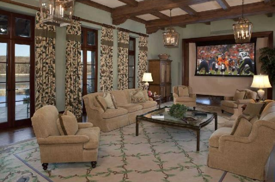 Country estate family room with retractable movie screen & cypress beamed ceiling