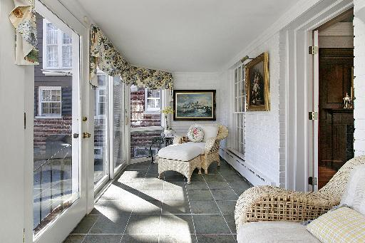 The-real-Planes-Trains-Automobiles-house-for-sale- sunroom via Hooked on Houses