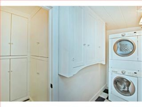 cute cottage laundry room Carmel Pacific Realty