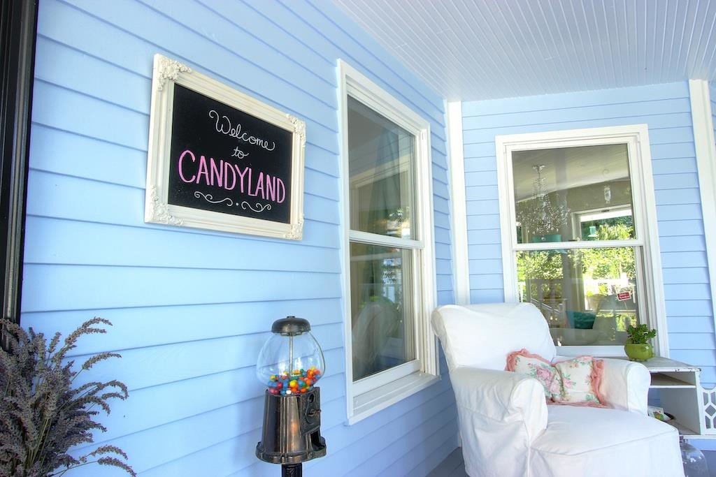 1225 SW 164th Vashon, WA French Country cottage storybook house - Welcome to Candyland porch sign - For sale Coldwell Banker
