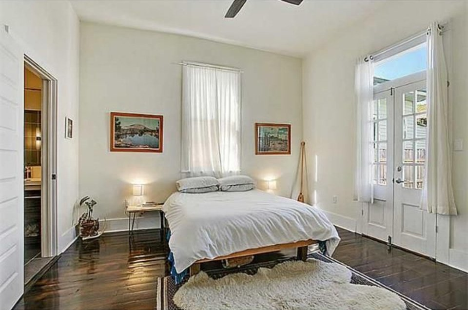 Colorful blue and yellow house in New Orleans house for sale