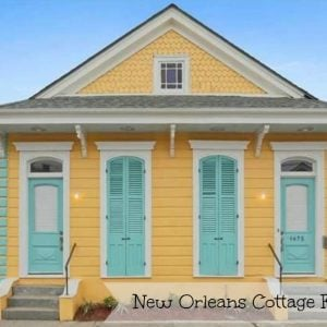 New Orleans house painted yellow with turquois shutters 2