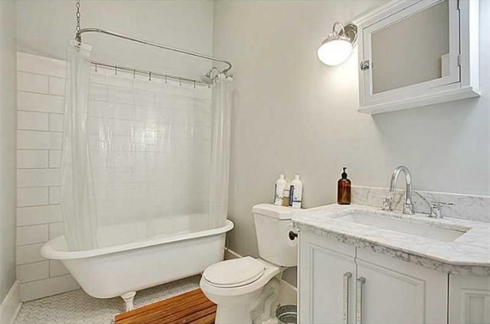 updated Bathroom inside blue and yellow house in New Orleans LA for sale