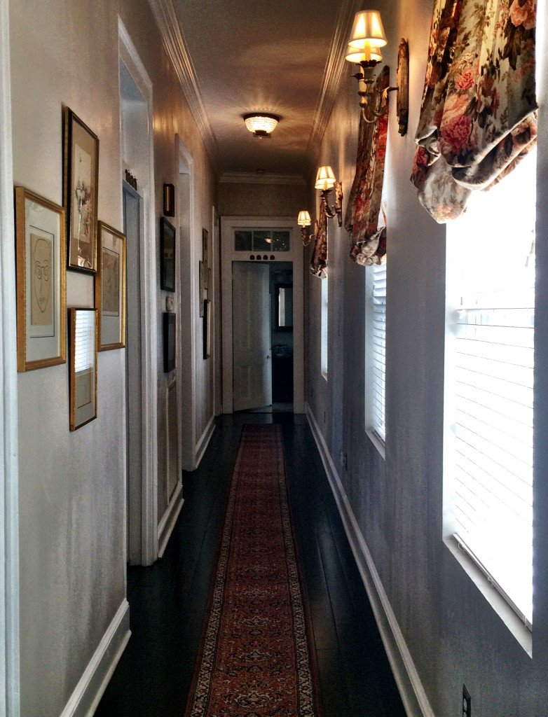 Long shot view of the upstairs hallway inside this 1875 Greek Revival - Happy Home Tour- A Pleasant House