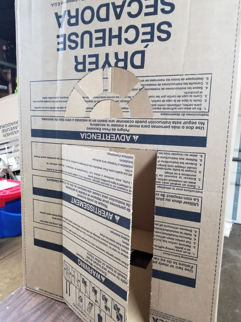 Combine washer and dryer cartons to make a cardboard playhouse
