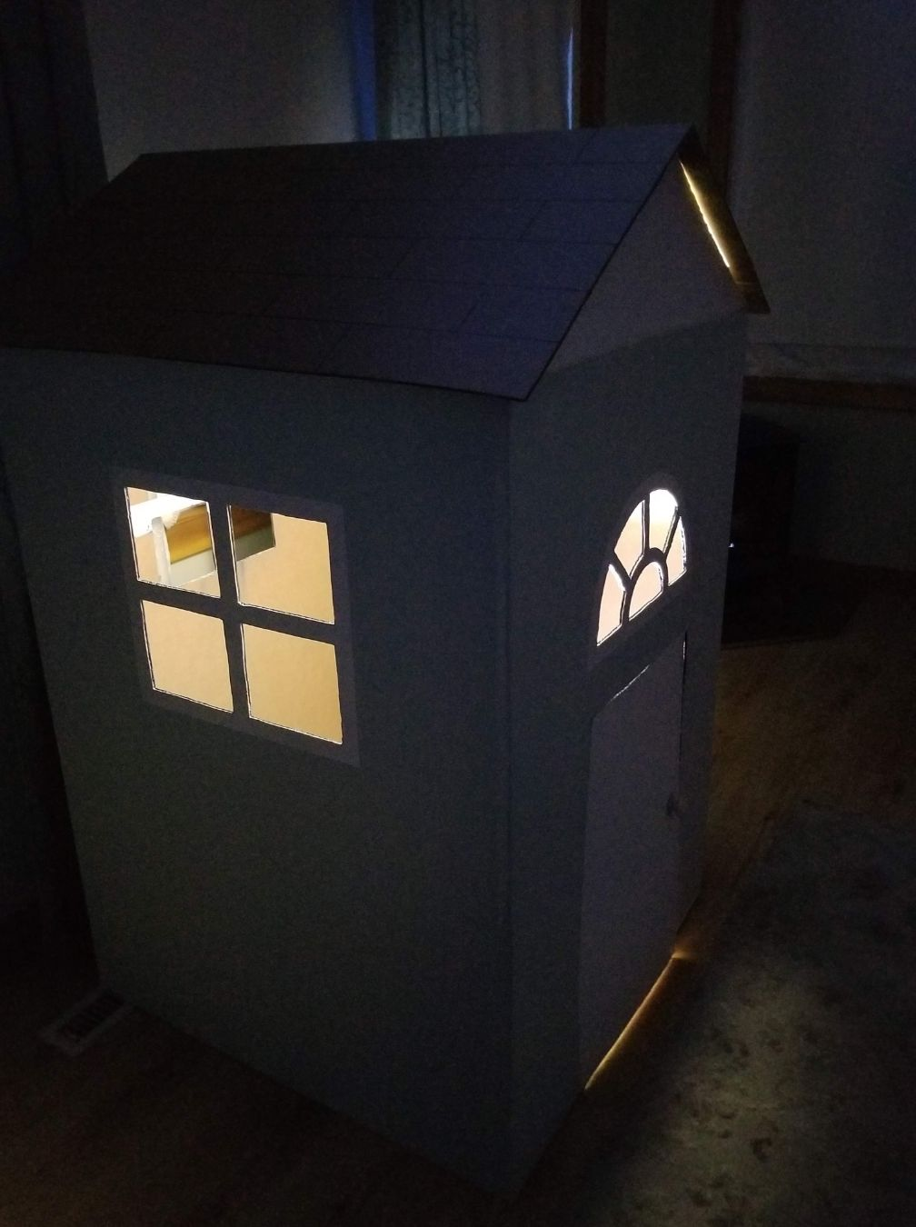 Add a light for more cardboard playhouse fun.