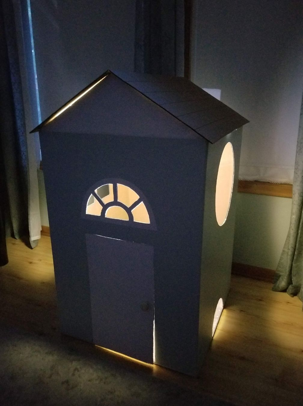 Kids like cardboard playhouses
