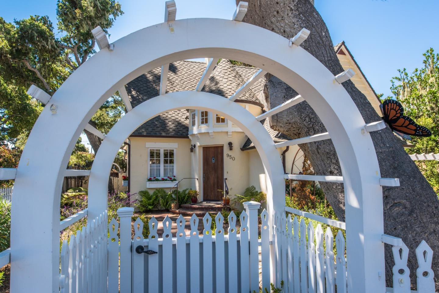 950 14th St, Pacific Grove, CA for sale in Candy Cane Lane neighborhood - white picket fence cottage arbor