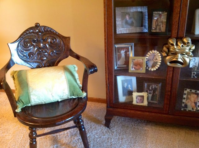 An antique chair with a carved face completes the look. Very cool how she  tied all this together. - At Home With Renaissance Mermaid Happy Home Tour