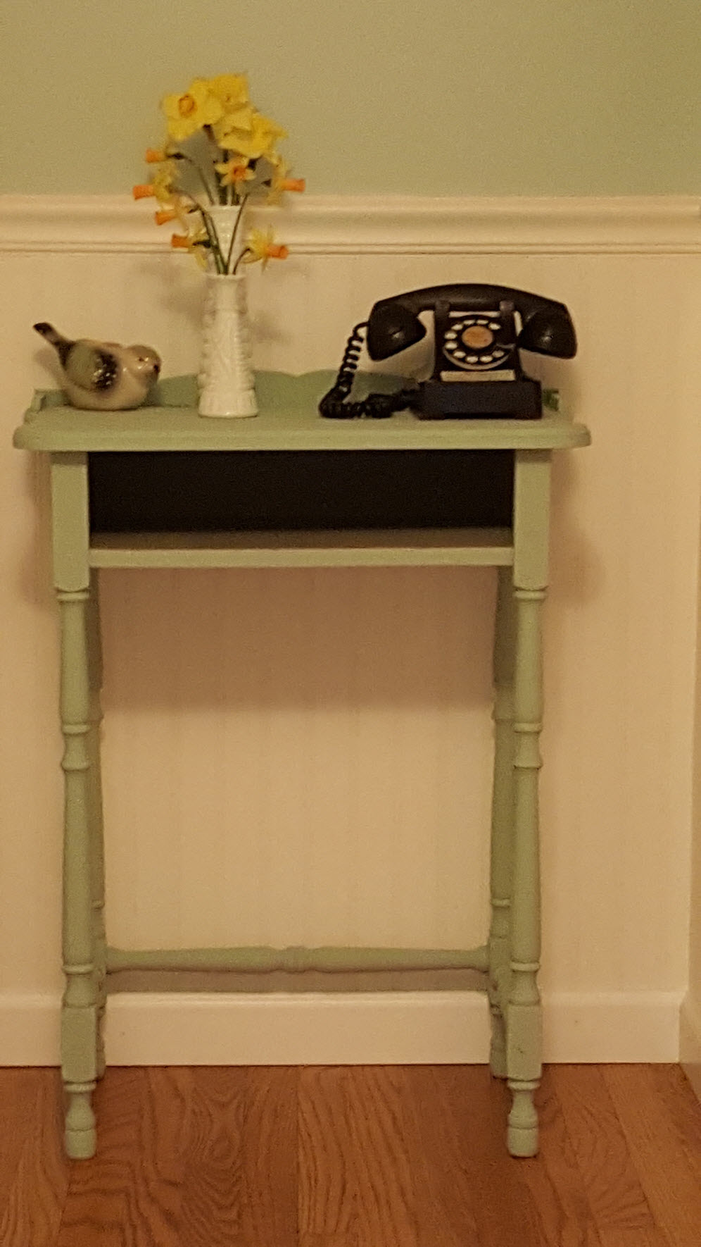 Antique table gets new life painted Poetic Blue and Silver Like. This is an old telephone table
