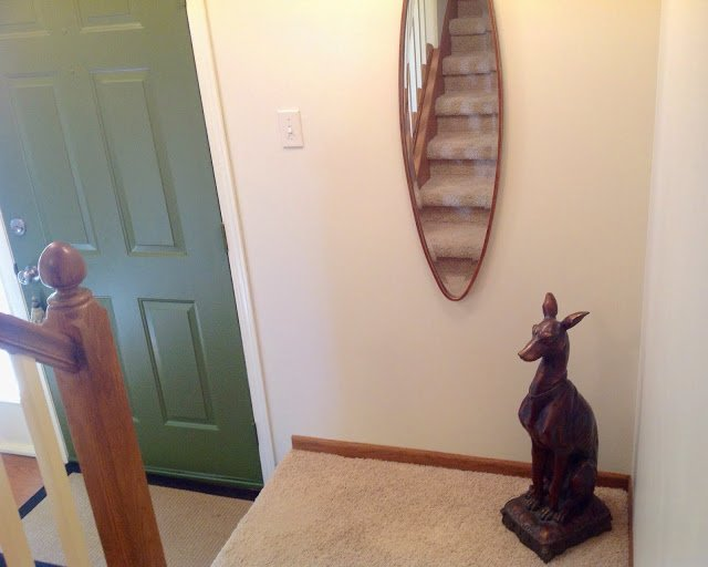 At home with Renaissance Mermaid stairway decorating personal touch with greyhound statue