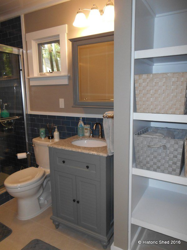Bath has storage shelves insice Tangerine Carriage House