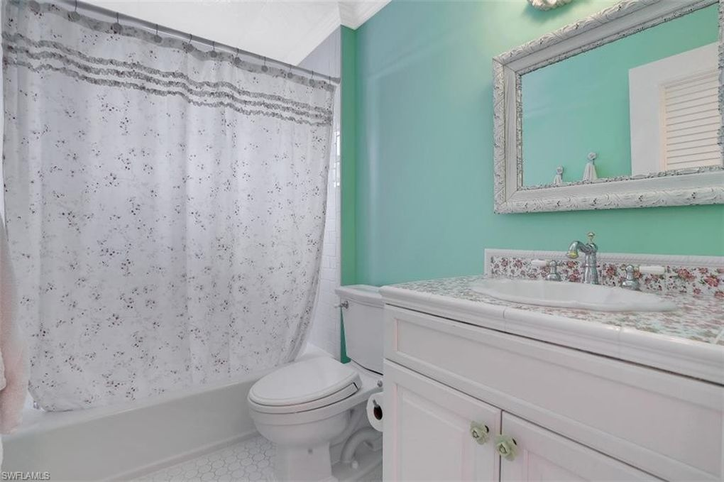Bathroom with pastel green paint - house for sale Naples FL