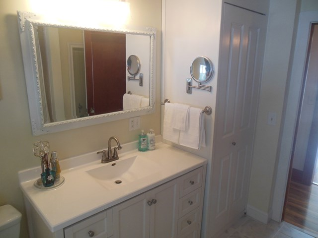 Bathroom with cottage white cabinets