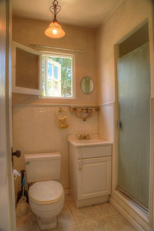 Bathroom with two-sided cottage style four pane window that opens out and inside.