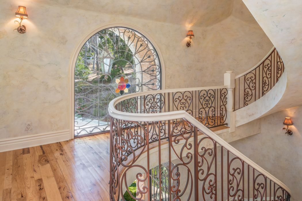Beach Boys Mike Love Selling Pebble Beach Home - 3108 Flavin Lane Pebble Beach CA - Beautiful Detailed Spiral staircase