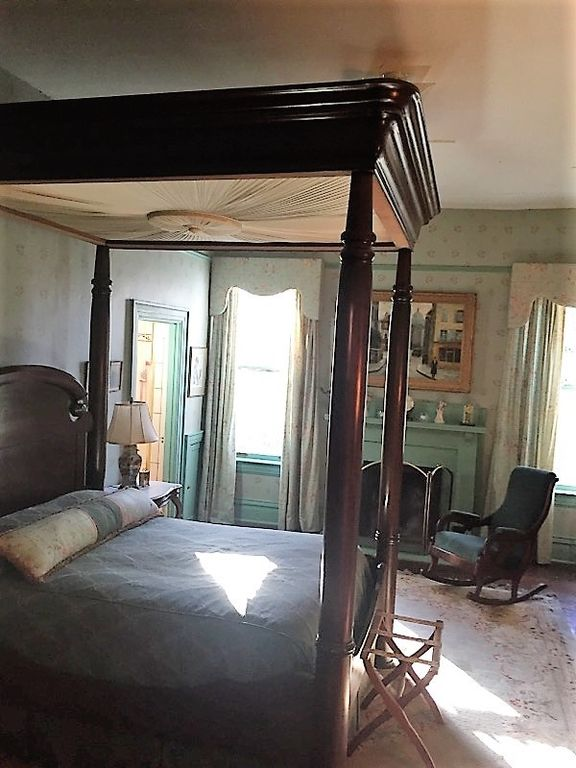 Skeeter's House is a stately Prairie style home for sale in Greenwood MS that has this grand historic style bed