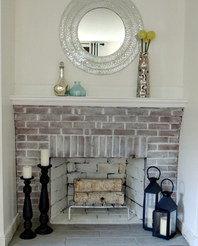 Cape Cod home tour white washed brick fireplace after photo - A Wife in Progress
